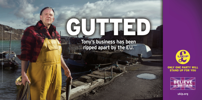 """A fisherman stands in yellow overalls by a harbour holding a rope in one hand and fish in the other. Next to his head reads the words 'Gutted: Tony's business has been ripped apart by the EU"""". The right hand side of the image shows UKIP's logo and the slogan """"Only one party will stand up for you""""."""